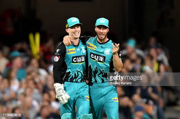 Jimmy Peirson of the Heat celebrates with team mate Chris Lynn after taking the wicket of Nick Hobson of the Scorchers during the Big Bash League...