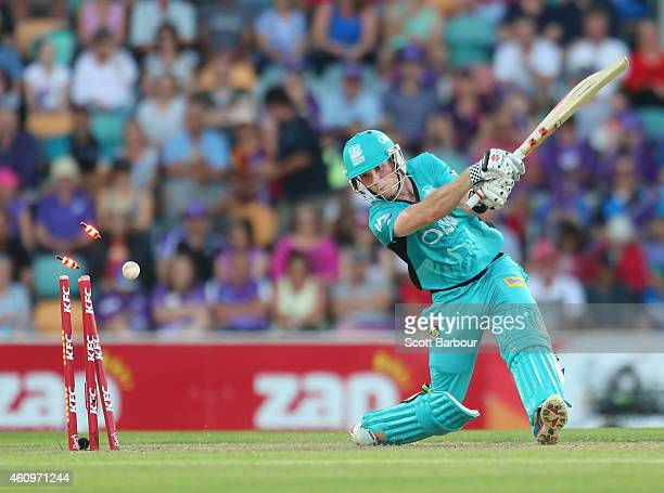 Jimmy Peirson of the Heat is out bowled by Darren Sammy of the Hurricanes during the Big Bash League match between the Hobart Hurricanes and the...