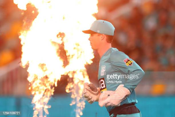 Jimmy Peirson of the Heat runs out for the the Big Bash League match between the Brisbane Heat and the Sydney Sixers at The Gabba, on January 02 in...