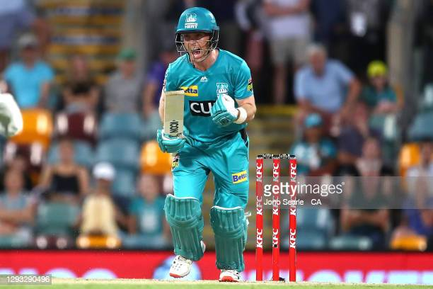 Jimmy Pierson of the Heat celebrates hitting the winning run during the Big Bash League match between the Brisbane Heat and the Hobart Hurricanes at...