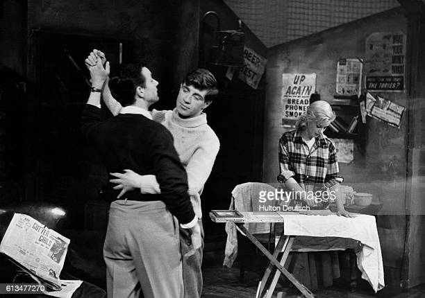 Jimmy Porter, played by Kenneth Haigh dances with his friend Cliff whilst his wife Alison does the ironing in a scene from John Osborne's 1956 play...