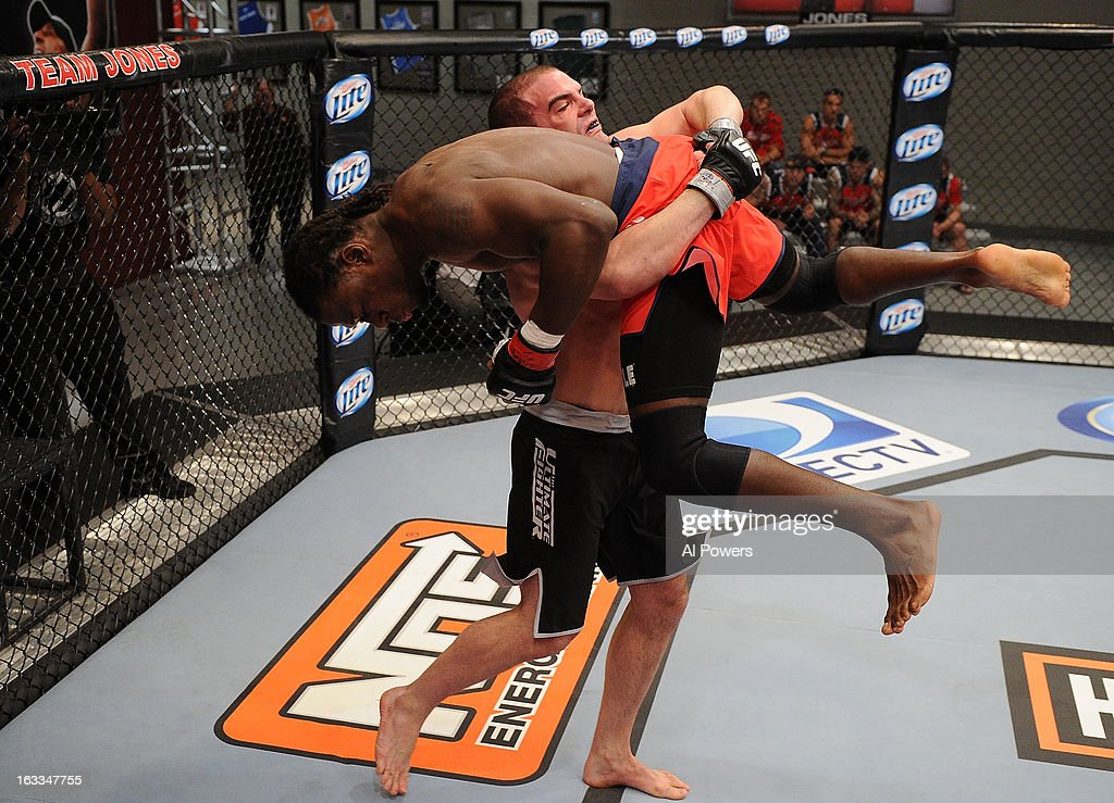 Jimmy Quinlan takes down Clint Hester in their preliminary fight during filming for season seventeen of The Ultimate Fighter at the UFC Training Center on November 20, 2012 in Las Vegas, Nevada.