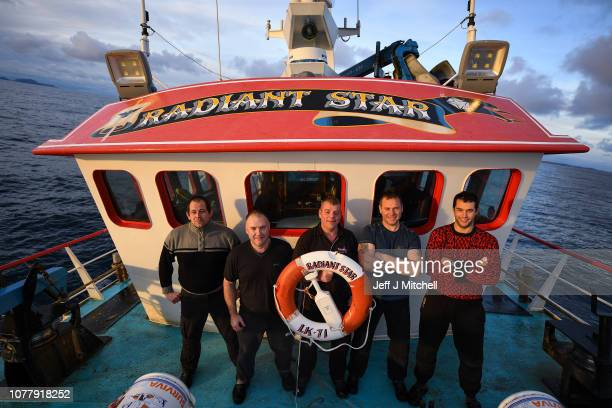 Jimmy ReidIan CouperVictor LaurensonVictor Duncan and Marven inkster crew members of the Radiant Star stand on deck during a days fishing in the...
