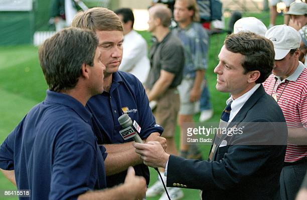 Jimmy Roberts interviews Fred Couples and Davis Love III during the 1996 Presidents Cup September 13-15, 1996 at Robert Trent Jones GC, Prince...