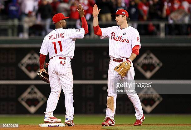 Jimmy Rollins and Chase Utley of the Philadelphia Phillies celebrate their 86 win against the New York Yankees in Game Five of the 2009 MLB World...