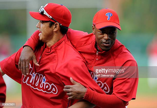 Jimmy Rollins and So Taguchi of the Philadelphia Phillies clown around during batting practice before Game 2 of the NLDS Playoff against the...