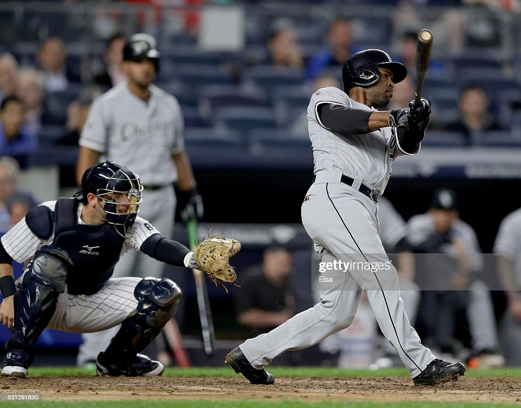 Jimmy Rollins #7 of the Chicago White Sox hits a two run home run as Austin Romine #27 of the New York Yankees defends in the third inning at Yankee Stadium on May 13, 2016 in the Bronx borough of New York City.