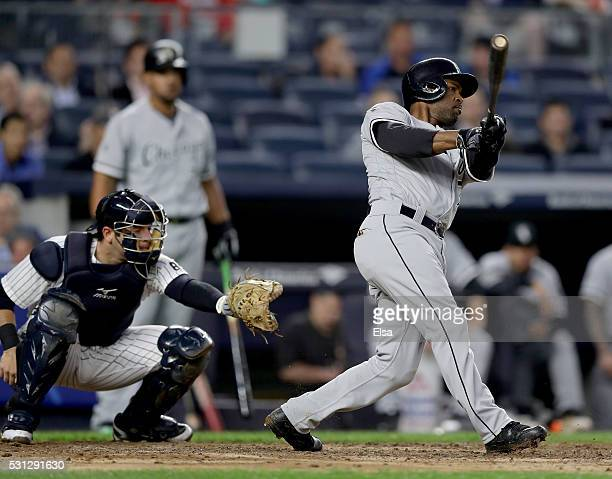 Jimmy Rollins of the Chicago White Sox hits a two run home run as Austin Romine of the New York Yankees defends in the third inning at Yankee Stadium...