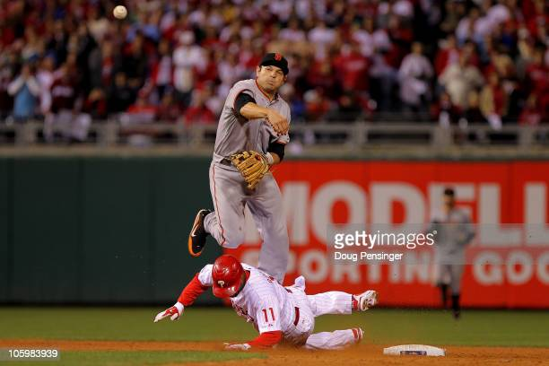Jimmy Rollins of the Philadelphia Phillies breaks up a double play under Freddy Sanchez of the San Francisco Giants in the ninth inning of Game Six...