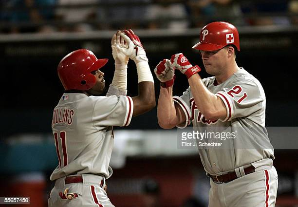Jimmy Rollins of the Philadelphia Phillies celebrates his two-run home run with teammate Jon Lieber in the third inning against the Florida Marlins...