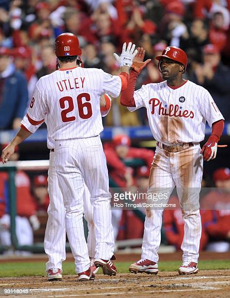 Jimmy Rollins of the Philadelphia Phillies greets Chase Utley after his home run against the New York Yankees in Game Five of the 2009 MLB World...