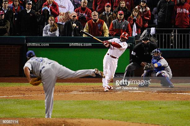 Jimmy Rollins of the Philadelphia Phillies hits a gamewinning walkoff 2run double in the bottom of the ninth inning to win 54 against Jonathan...