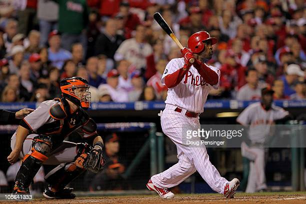 Jimmy Rollins of the Philadelphia Phillies hits a three run double to left field in the seventh inning against the San Francisco Giants in Game Two...