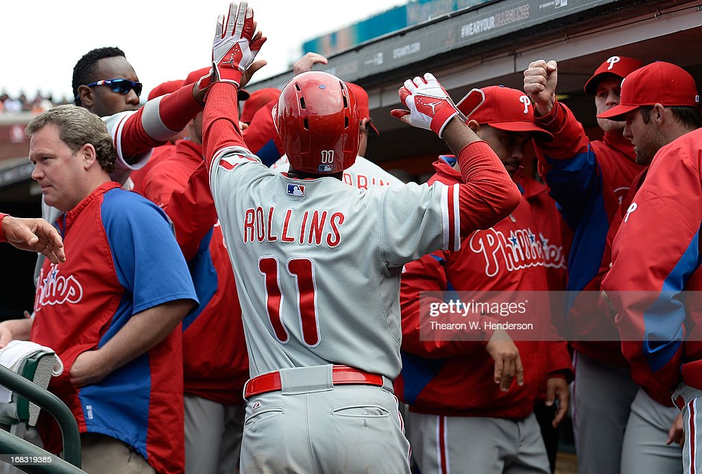 Jimmy Rollins #11 of the Philadelphia Phillies is congratulated by teammates after he scored on an RBI single from Chase Utley #26 (not pictured) against the San Francisco Giants in the ninth inning at AT&T Park on May 8, 2013 in San Francisco, California.
