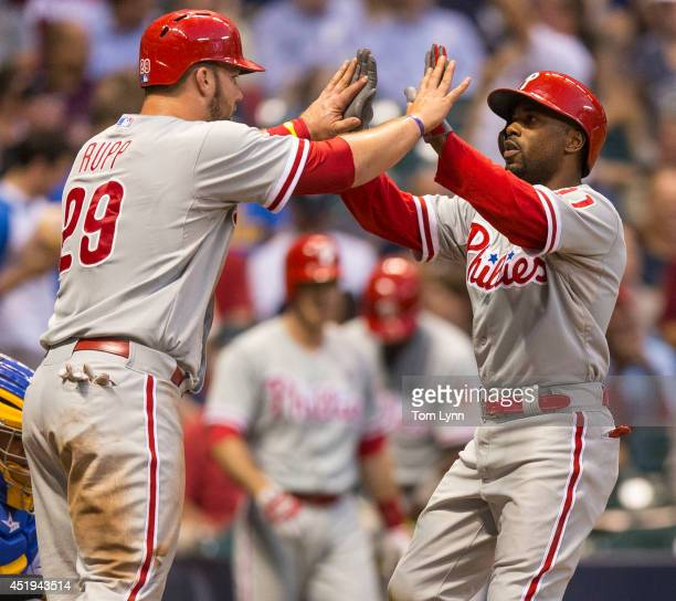 Jimmy Rollins of the Philadelphia Phillies is greeted by teammate Cameron Rupp after hitting a two run home run off of Kyle Lohse of the Milwaukee...