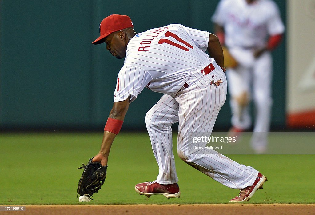 Jimmy Rollins #11 of the Philadelphia Phillies is unable to field the ball in the eighth inning against the Washington Nationals at Citizens Bank Park on July 9, 2013 in Philadelphia, Pennsylvania. The Phillies won 4-2.