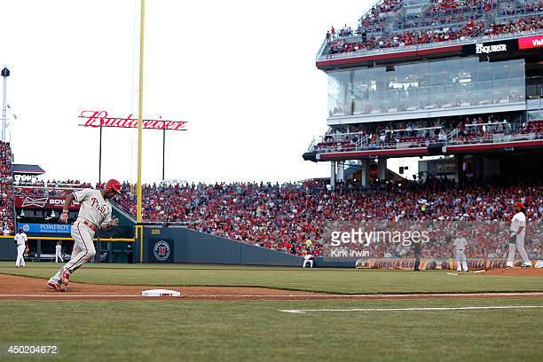 Jimmy Rollins of the Philadelphia Phillies rounds third base after hitting a home run off of Johnny Cueto of the Cincinnati Reds during the fifth...