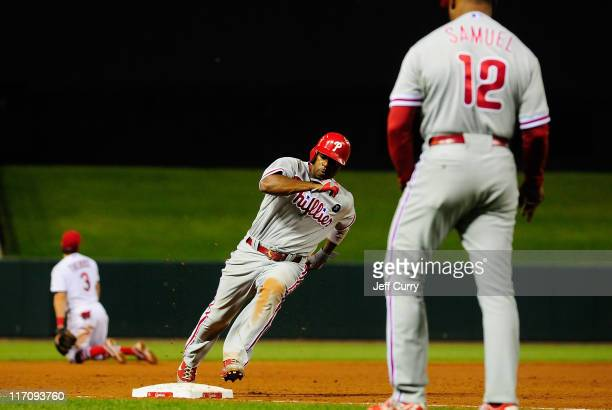 Jimmy Rollins of the Philadelphia Phillies rounds third base on a hit by Chase Utley against the St Louis Cardinals at Busch Stadium on June 21 2011...