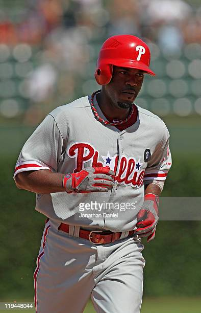 Jimmy Rollins of the Philadelphia Phillies runs the bases after hitting the first of two home run against the Chicago Cubs at Wrigley Field on July...