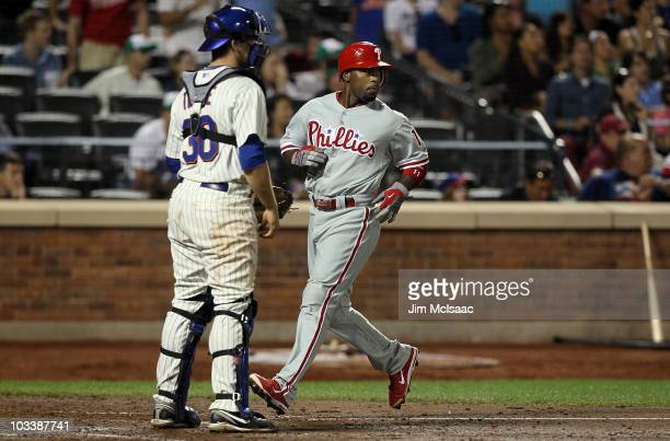 Jimmy Rollins of the Philadelphia Phillies scores a fifth inning run past Josh Thole of the New York Mets on August 14 2010 at Citi Field in the...