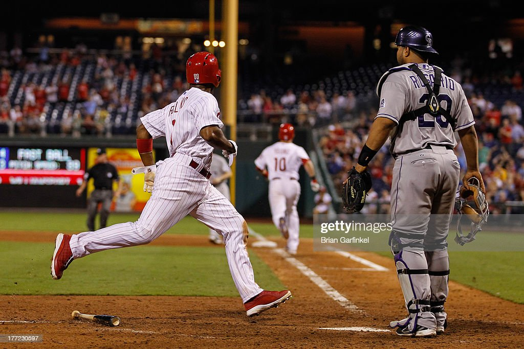 Jimmy Rollins #11 of the Philadelphia Phillies scores a run off of a Michael Young #10 RBI single to tie the game in the bottom of the ninth inning of the game against the Colorado Rockies at Citizens Bank Park on August 22, 2013 in Philadelphia, Pennsylvania. The Phillies won 5-4.
