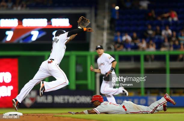 Jimmy Rollins of the Philadelphia Phillies steals second as Adeiny Hechavarria of the Miami Marlins tries to fieeld the throw during a game at...