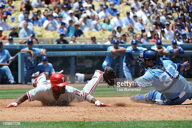 Jimmy Rollins of the Philadelphia Phillies tagged out at home plate by Dioner Navarro of the Los Angeles Dodgers in the third inning at Dodger...