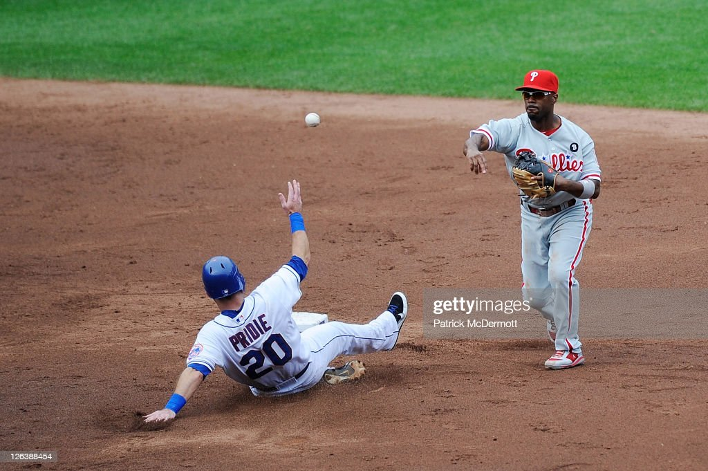 Jimmy Rollins #11 of the Philadelphia Phillies turns a double play as Jason Pridie #20 of the New York Mets slides to second base in the third inning during a game at Citi Field on September 25, 2011 in the Flushing neighborhood of the Queens borough of New York City.