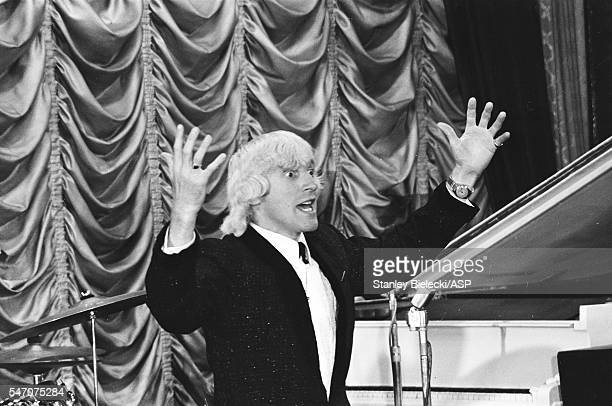 Jimmy Savile as the compere introduces Gerry The Pacemakers during rehearsals of the talent show scenes for Jeremy Summers' musical film 'Ferry Cross...