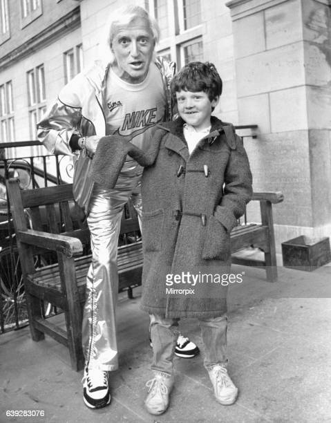 Jimmy Savile meets seven year old Lee Claffey of Eastwood Gardens Kenton Newcastle who was visiting the Royal Victoria Infirmary to have his broken...