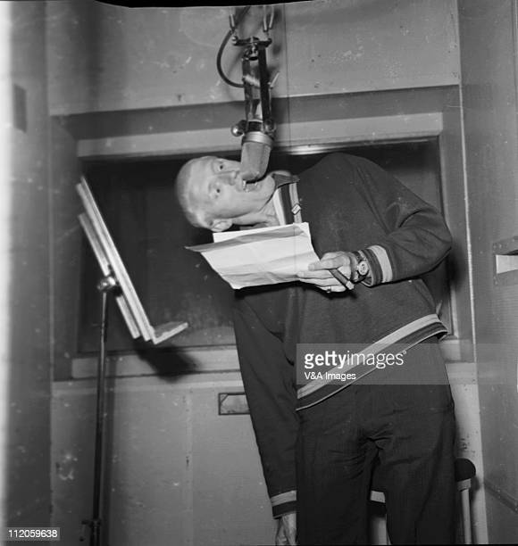 Jimmy Saville posed in recording studio speaking into microphone upside down 1963