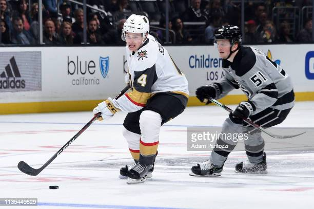 Jimmy Schuldt of the Vegas Golden Knights skates with the puck with pressure from Austin Wagner of the Los Angeles Kings during Schuldt's NHL debut...