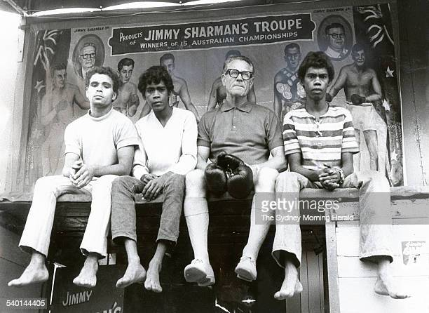 Jimmy Sharman with three members of the Jimmy Sharman Boxing Troupe: Gerry Hobbley from Milanda, Queensland, and Wally and Max Snider from Kuranda...