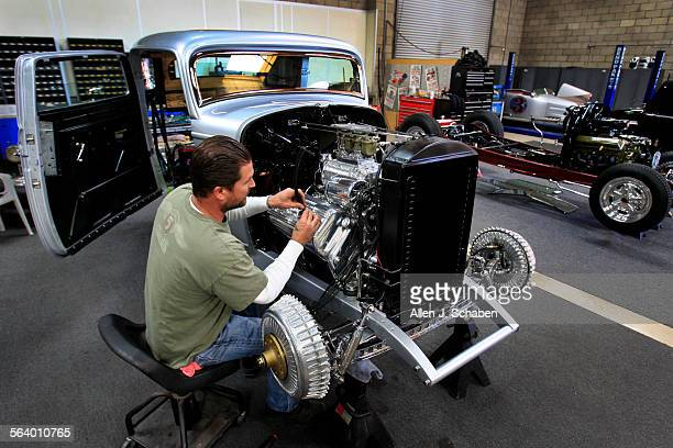 Jimmy Shine shop manager at SOCAL Speed Shop works on a 1932 Ford chopped 3 window highboy coupe owned by Bill Lindig of Houston Tx which Shine was...