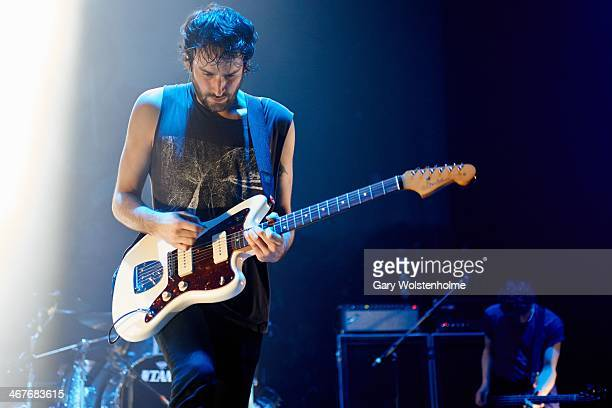 Jimmy Smith of Foals performs on stage at Manchester Apollo on February 7 2014 in Manchester United Kingdom