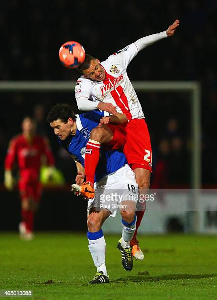 Jimmy Smith of Stevenage wins a header against Gareth Barry of Everton during the Budweiser FA Cup fourth round match between Stevenage and Everton...