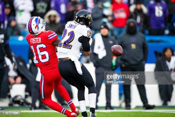Jimmy Smith of the Baltimore Ravens breaks up a pass intended for Robert Foster of the Buffalo Bills at the end of the third quarter at New Era Field...
