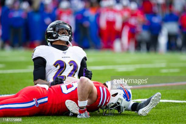 Jimmy Smith of the Baltimore Ravens celebrates breaking up a pass intended for Dawson Knox of the Buffalo Bills during the third quarter at New Era...