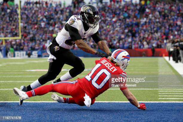 Jimmy Smith of the Baltimore Ravens pushes Cole Beasley of the Buffalo Bills to the ground as he completes a two point conversion during the fourth...