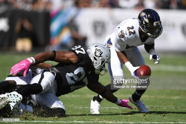 Jimmy Smith of the Baltimore Ravens returns a recovered fumble by Jared Cook of the Oakland Raiders for a touchdown during their NFL game at...