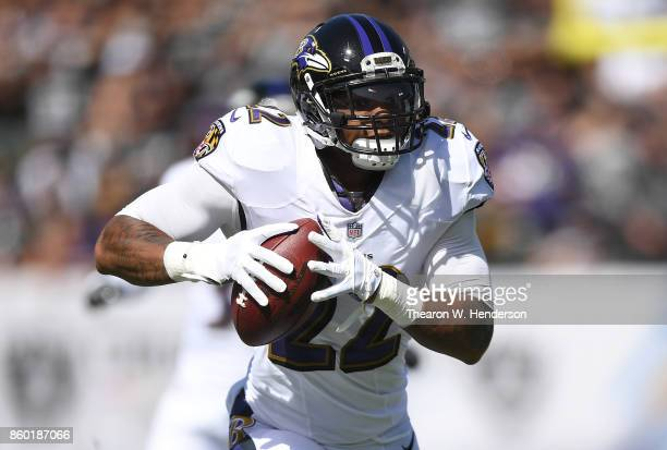 Jimmy Smith of the Baltimore Ravens returns a recovered fumble by Jared Cook of the Oakland Raiders for a touchdown during the first quarter of their...