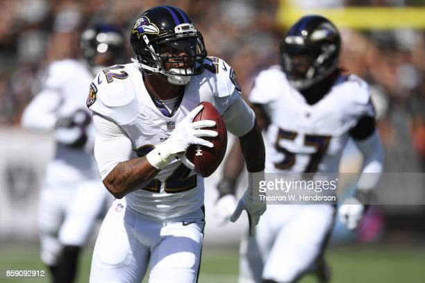 Jimmy Smith of the Baltimore Ravens returns a recovered fumble for a touchdown against the Oakland Raiders during their NFL game at Oakland-Alameda...
