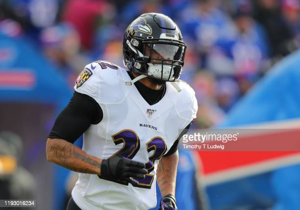 Jimmy Smith of the Baltimore Ravens runs onto the field before a game against the Buffalo Bills at New Era Field on December 8, 2019 in Orchard Park,...