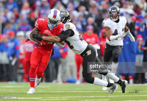 Jimmy Smith of the Baltimore Ravens tackles John Brown of the Buffalo Bills after making a catch during the second half at New Era Field on December...