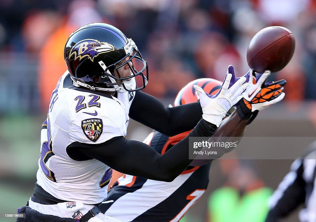 Jimmy Smith #22 of the Baltimore Ravensreaches for the ball during the NFL game against the Cincinnati Bengals at Paul Brown Stadium on December 30, 2012 in Cincinnati, Ohio.