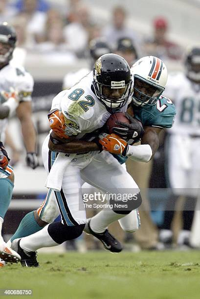Jimmy Smith of the Jacksonville Jaguars gets tackled by Patrick Surtain of the Miami Dolphins during a game on October 12 2003 at the Alltell Stadium...