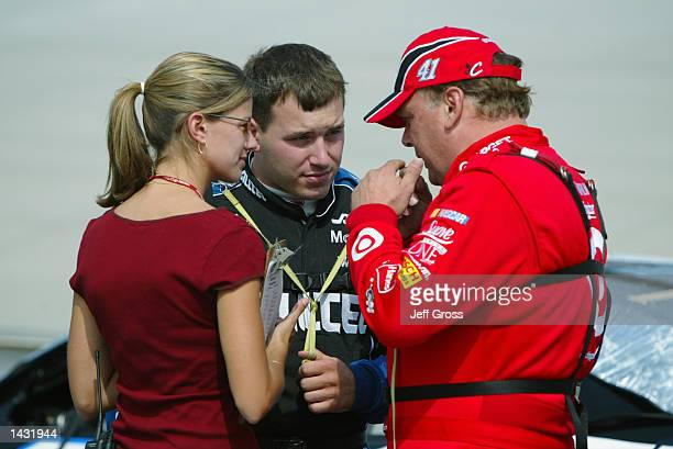 Jimmy Spencer driver of the Ganassi Racing Dodge Intrepid RT talks with driver Ryan Newman and Newman's girlfriend Krissie during qualifying for the...