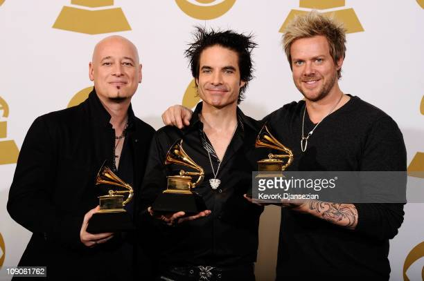 Jimmy Stafford Pat Monahan and Scott Underwood of the band Train winners of the Best Pop Performance By A Duo Or Group With Vocals award for Hey Soul...