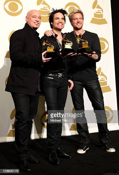 Jimmy Stafford Pat Monahan and Scott Underwood of the band Train pose in the press room at The 53rd Annual GRAMMY Awards held at Staples Center on...