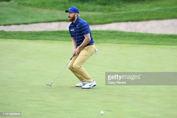 Jimmy Stanger reacts to a missed birdie putt on the 18th green during the final round of the Evans Scholar Invitational at the Glen Club on May 26...
